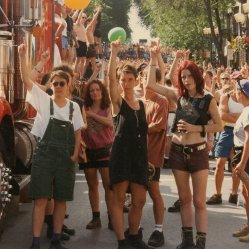 Pride March. The crowd is still and observes a minute of silence for the victims of HIV/aids.] August 1996. Picture Credit : Michel Bazinet. Collection des Archives gaies du Québec.