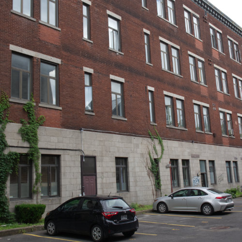 École Gilford's back facade today. On Gilford street and De Lorimier avenue. Picture Credit : Marion Daigle. Collection des Archives gaies du Québec.